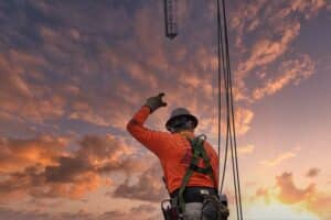 crane worker giving crane hand signals